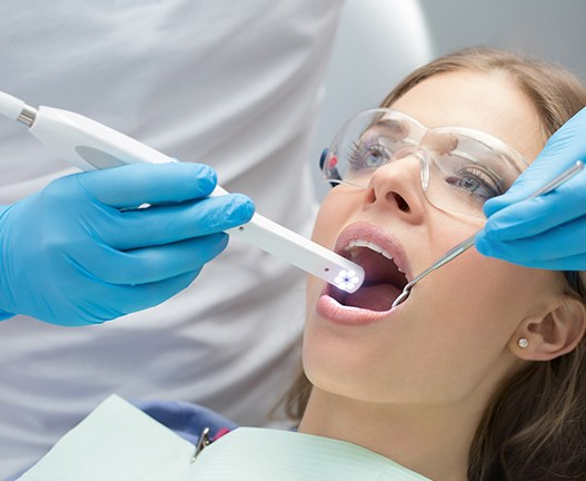 dentist using intraoral camera on mouth